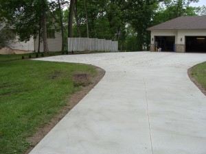 Concrete Driveway Leading Up to Garage