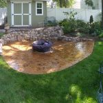 concrete patio with fire pit on top