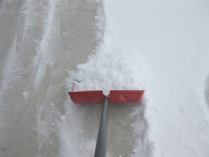 shoveling concrete driveway in winter